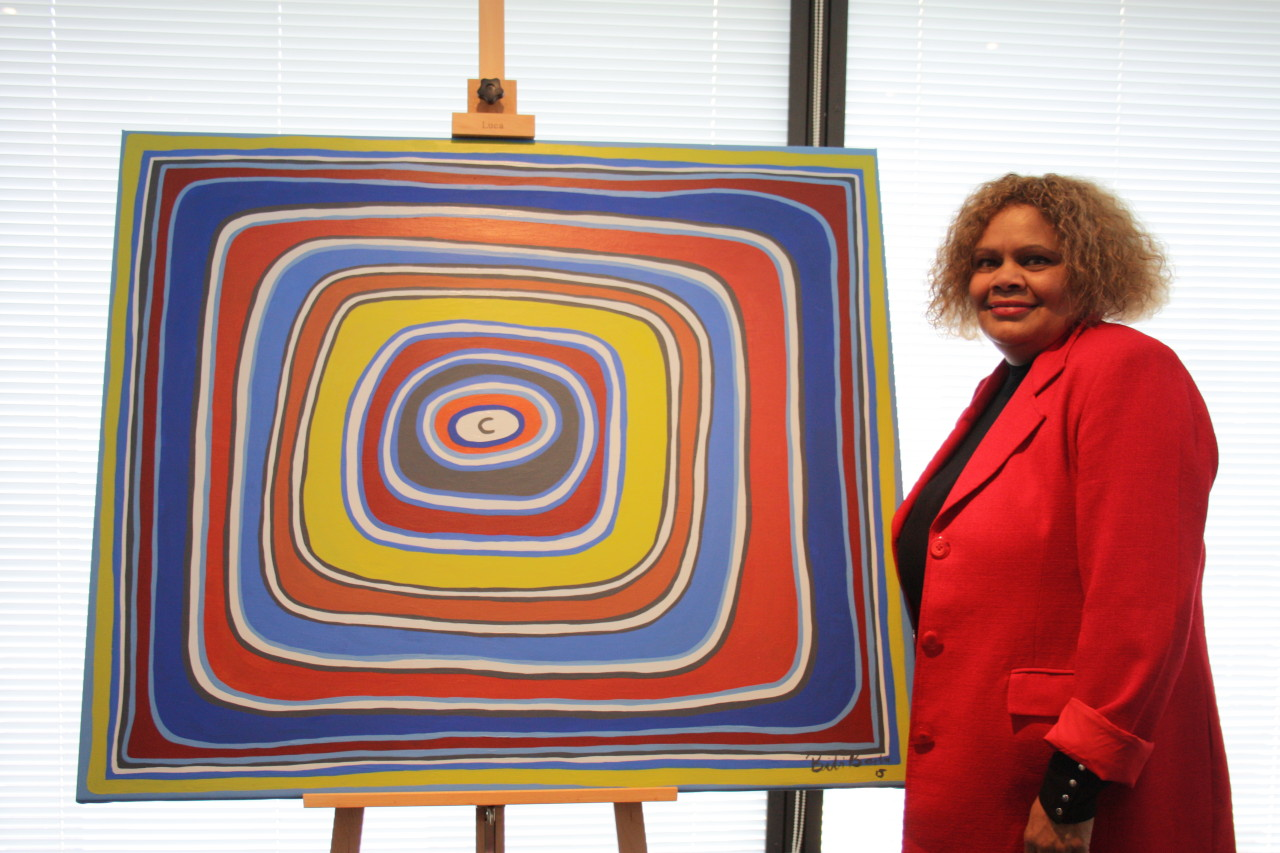 Bibi Barba with her artwork, (Blanket of Security) Dreaming, which reflects her experience of finding her artwork used by an interior designer of a Polish hotel without her permission. © Bibi Barba/Licensed by Viscopy, 2015.