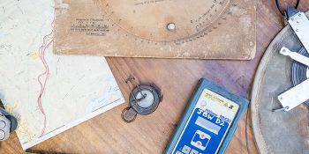 Surveyor equipment on a wooden table.