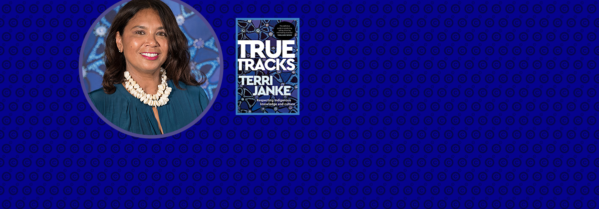 Photograph of Terri Janke with her book True Tracks.