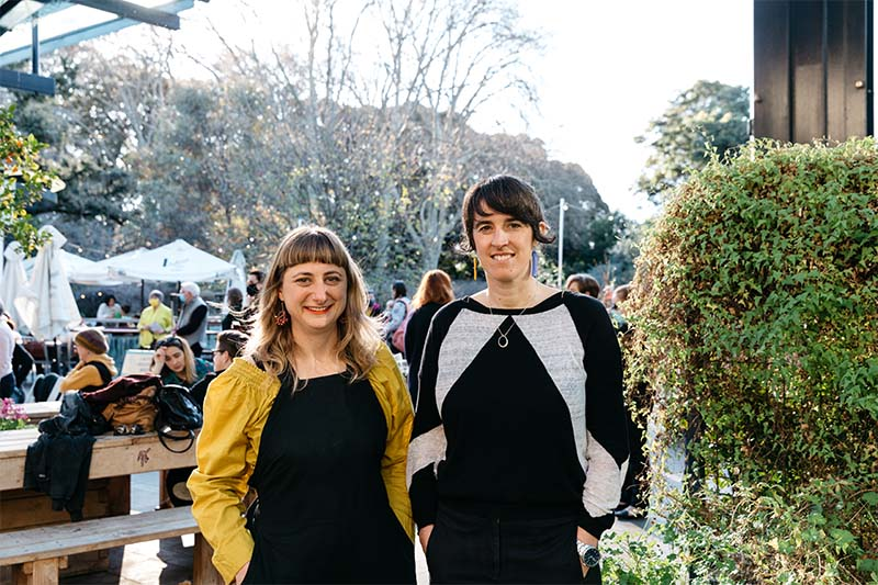 A photo of South Australian artists Laura Flaherty and Laura Will standing side by side.