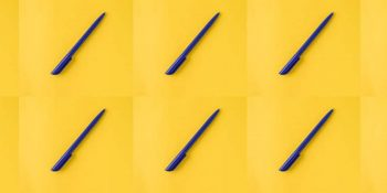 Bright yellow background with blue pens.